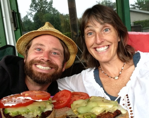 Billy and his girlfriend eat a black bean burger, with sauerkraut, avocado, and tomato.  A disaster waiting to happen!